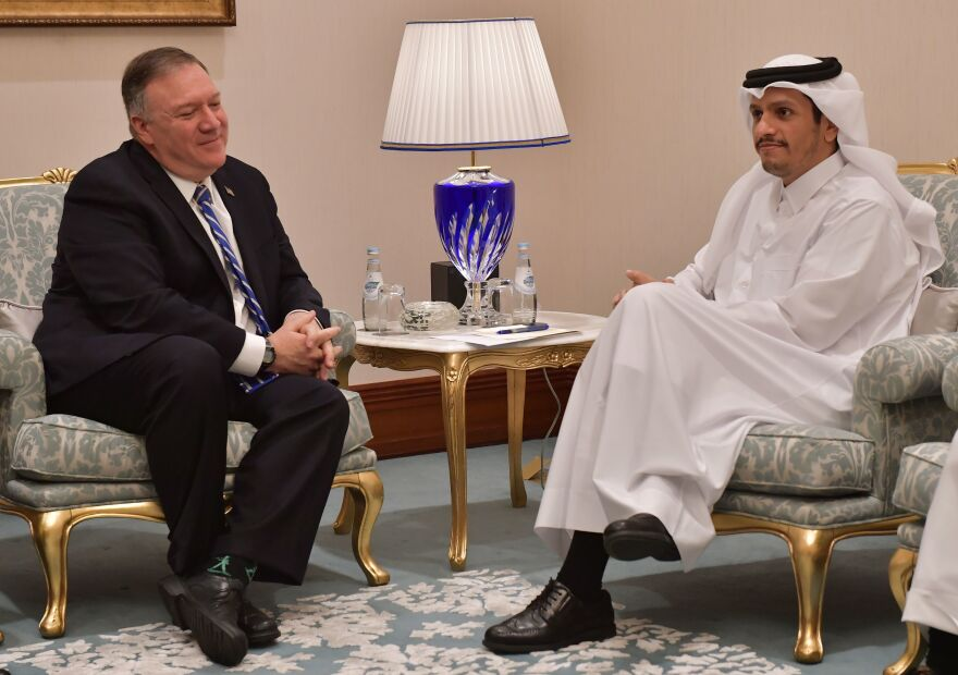 Secretary of State Mike Pompeo, left, meets with Qatari Deputy Prime Minister and Minister of Foreign Affairs Sheikh Mohammed bin Abdulrahman al-Thani ahead of Saturday's signing ceremony between the U.S. and the Taliban in Qatar's capital, Doha.
