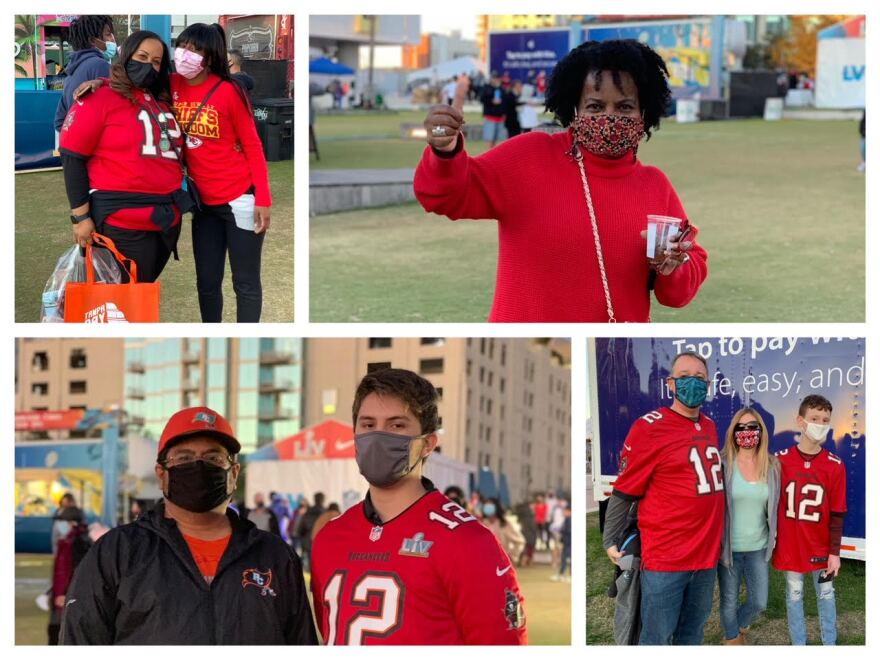Several men and women in masks and Tampa Bay Buccaneers attire pose at the NFL Super Bowl Experience event in downtown Tampa.