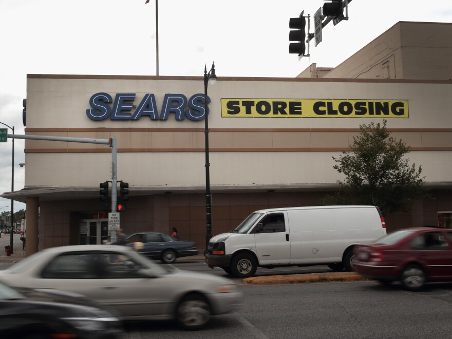 A sign announcing a store closing hangs above a Sears in Chicago. The bankruptcy filing could mark the end of the struggling retailer, which invented the mail-order catalog business.