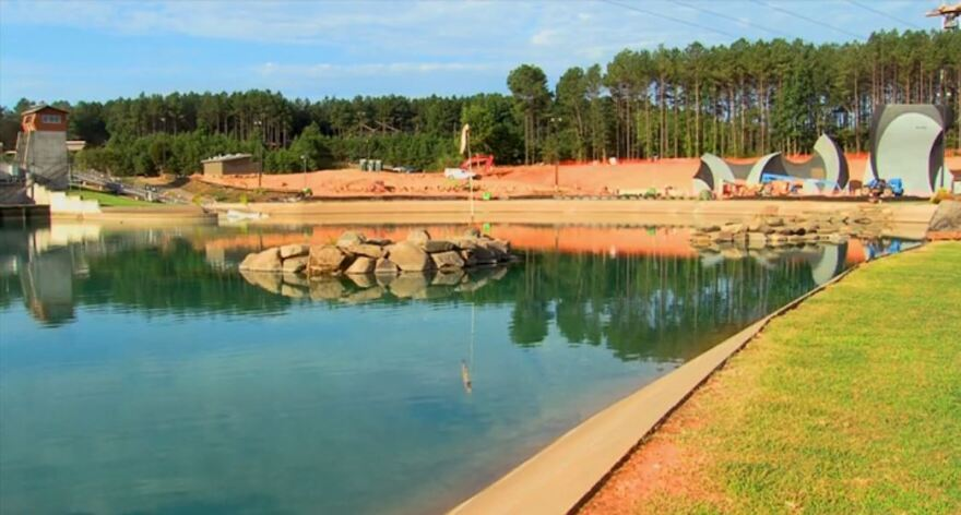 Water level at the U.S. National Whitewater Center basin began to fall as the water was discharged. The center will remove sediment and clean the basin before it reopens the rafting channel. The rest of the center remains open.