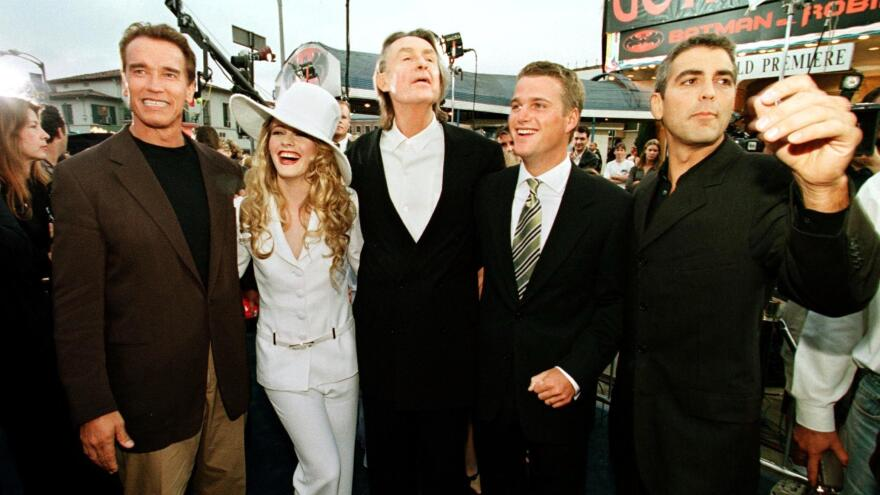 Director Joel Schumacher (center) along with Arnold Schwarzenegger, Alicia Silverstone, Chris O'Donnell and George Clooney (left to right) at the premier for <em>Batman & Robin</em>. The director died Monday at age 80.