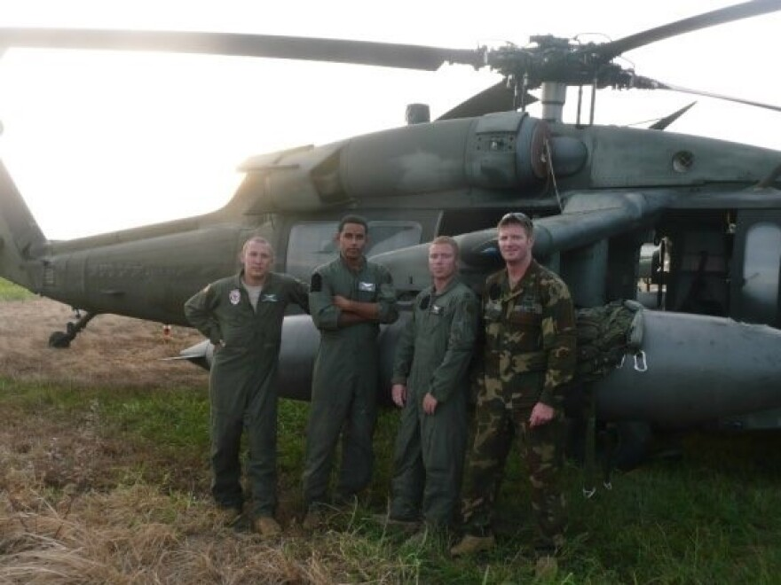 Former Army pilot Tony Zimlich and his crew pose outside of their Black Hawk helicopter, on an emergency rescue assignment in Honduras in 2008.