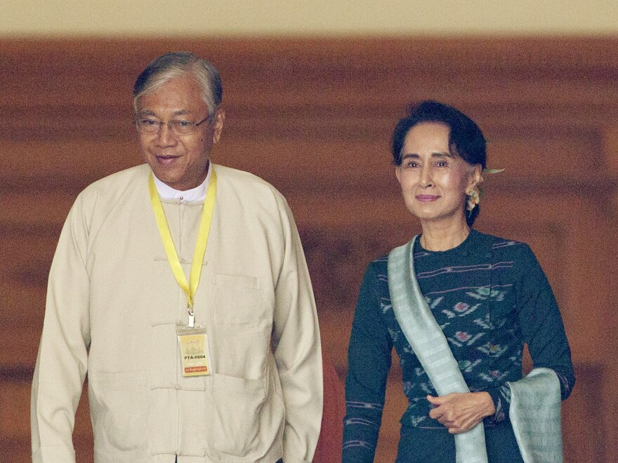 U Htin Kyaw (left), newly elected president of Myanmar, walks with National League for Democracy leader Aung San Suu Kyi at Myanmar's Parliament in Naypyitaw on Tuesday.