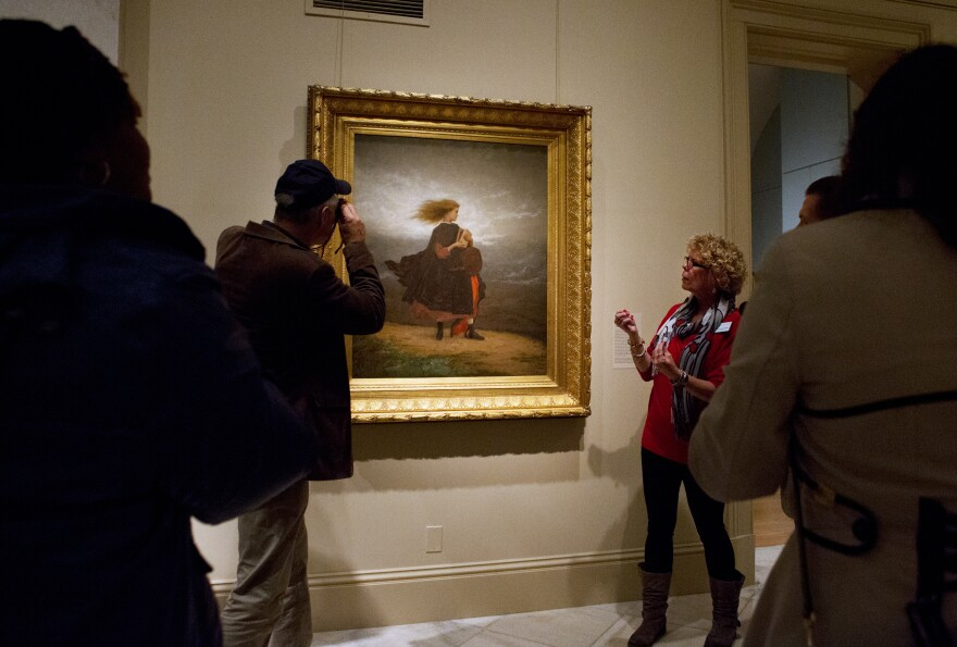 At the Smithsonian American Art Museum, specially trained docents lead twice-a-month tours for blind and visually impaired art lovers. (Above) Betsy Hennigan describes a painting to visitors on an America InSight tour.