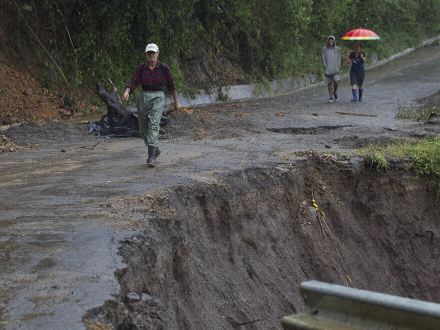 A road was washed out Thursday on the outskirts of San Jose, Costa Rica, where at least seven people were reported killed from Tropical Storm Nate.