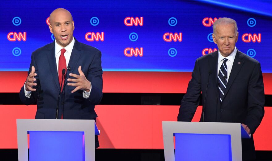New Jersey Sen. Cory Booker delivers his closing statement flanked by former Vice President Joe Biden during the Democratic presidential debate in Detroit on Wednesday night. Booker pressed Biden on his record on criminal justice.