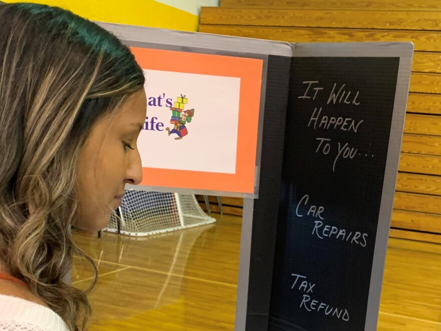 """Yazmin Ramirez, 16, goes to a station called """"That's Life"""" at the Big Bank Theory exercise at Bayshore High School in Bradenton, Florida. Kerry Sheridan/WUSF"""