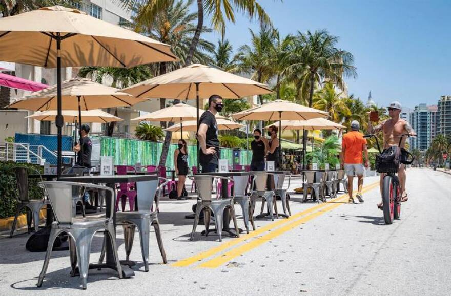 Seating at Pink Taco expands onto closed-off Ocean Drive in South Beach on Wednesday, May 27, 2020.
