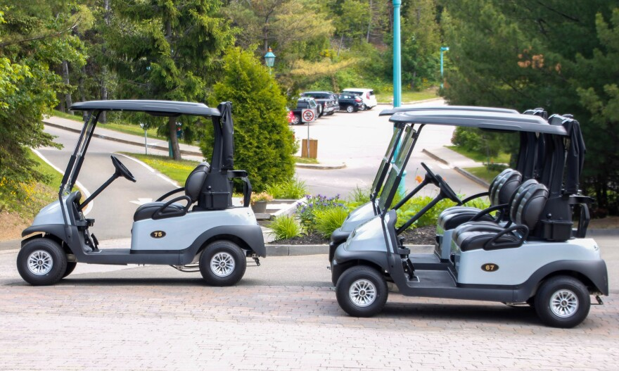 Photo of two golf carts
