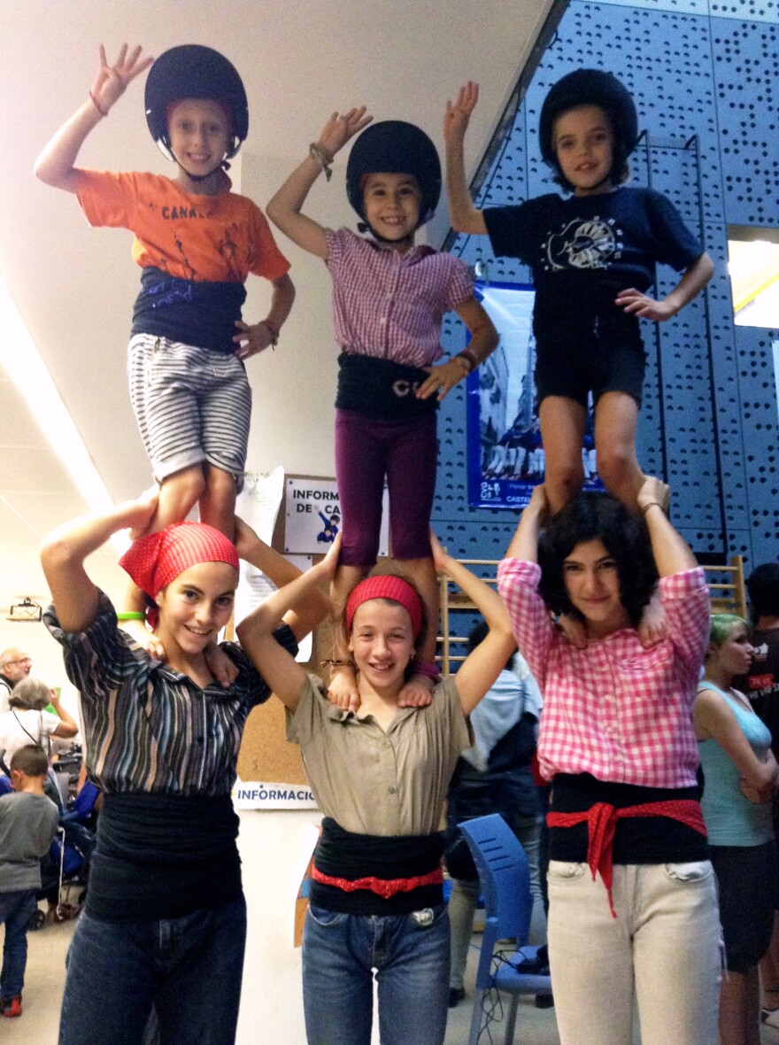 These <em>enxanetas — </em>the agile and light girls who climb all the way to the top of the <em>castells</em> — practice at their local club in Barcelona. Participants perform barefoot, but youngsters wear safety helmets.