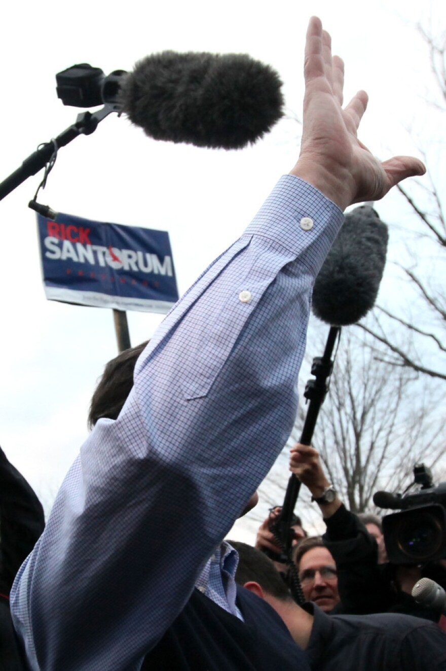 Reporters stick close to Republican presidential candidate Rick Santorum as he greets voters in Hollis, New Hampshire on Sunday.