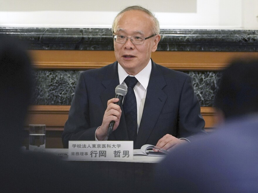 Tetsuo Yukioka, managing director of Tokyo Medical University, speaks during a press conference Tuesday, Aug. 7 in Tokyo. The school confirmed that it systematically altered entrance exam scores for years to keep out female applicants and ensure more men became doctors.