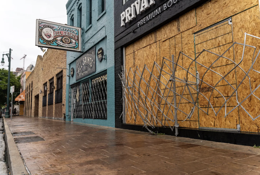Boarded up bars on Sixth Street in Austin.