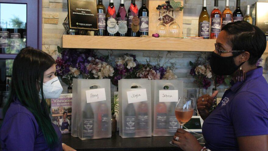 Jennifer McDonald prepares to-go orders at her urban winery, Jenny Dawn Cellars, in Wichita, Kansas in August 2020.
