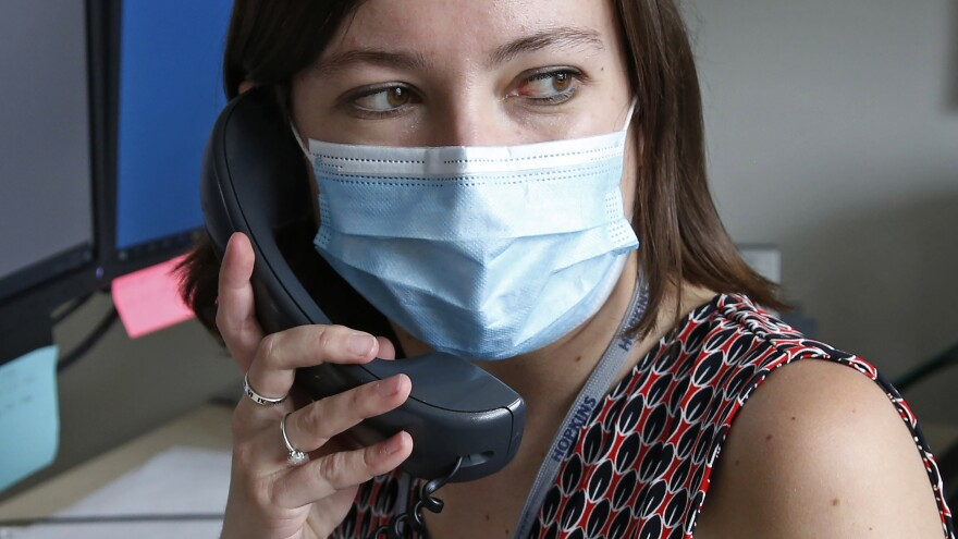 Health investigator Mackenzie Bray of the Salt Lake County Health Department in Salt Lake City, Utah, contacts people who may have been exposed to the coronavirus so they can get tested and quarantine themselves. Thousands of health workers around the country are doing this work to help keep outbreaks from flaring up.