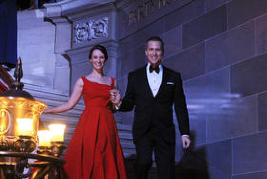 Greitens and his wife descend stairs in the state Capitol's rotunda for the start of Monday's inaugural ball.