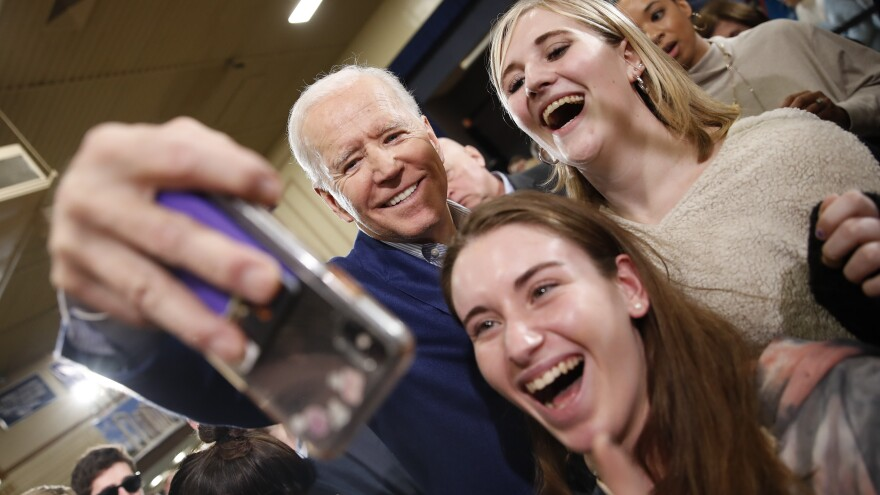 Former Vice President Joe Biden, takes photos with supporters during a campaign event at St. George Greek Orthodox Cathedral in Manchester, N.H., on Monday.