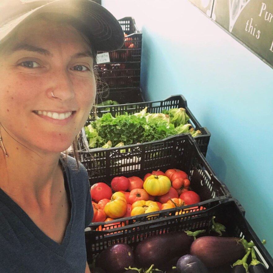 Sarah Voiland, who helps run Red Fire Farm, delivers fresh produce for the Brighton CSA in the Boston area in 2019.