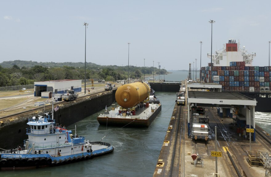 The tugboat and barge transporting NASA's only remaining space shuttle external tank, makes it through the Gatun locks of the Panama Canal, Panama, in April.