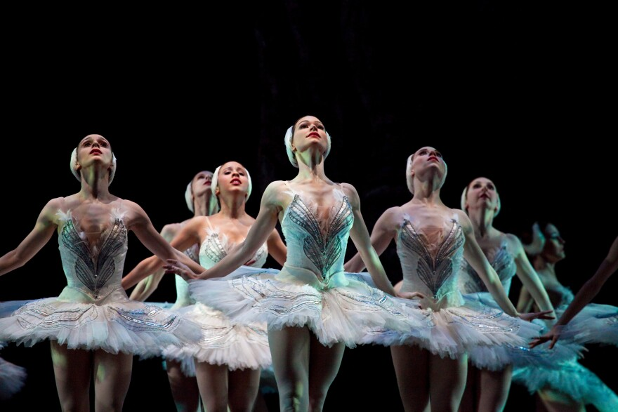 Photo of ballet dancers in swan lake costumes.