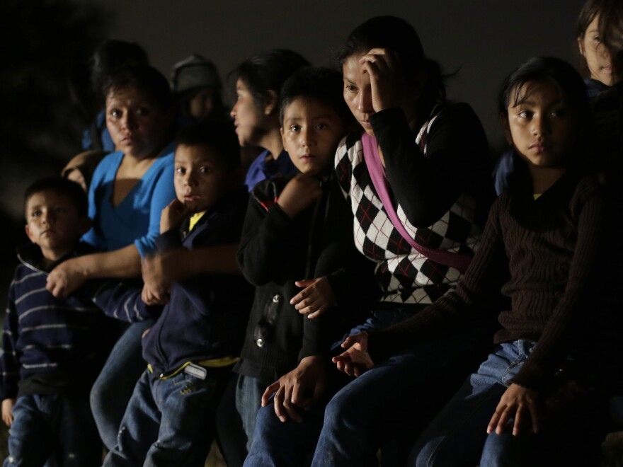 Immigrants from Honduras and El Salvador who crossed the U.S.-Mexico border illegally are stopped in Granjeno, Texas, on June 25. President Obama asked Congress this week for $3.7 billion to cope with thousands of minors from Central America who are illegally crossing the U.S. border.