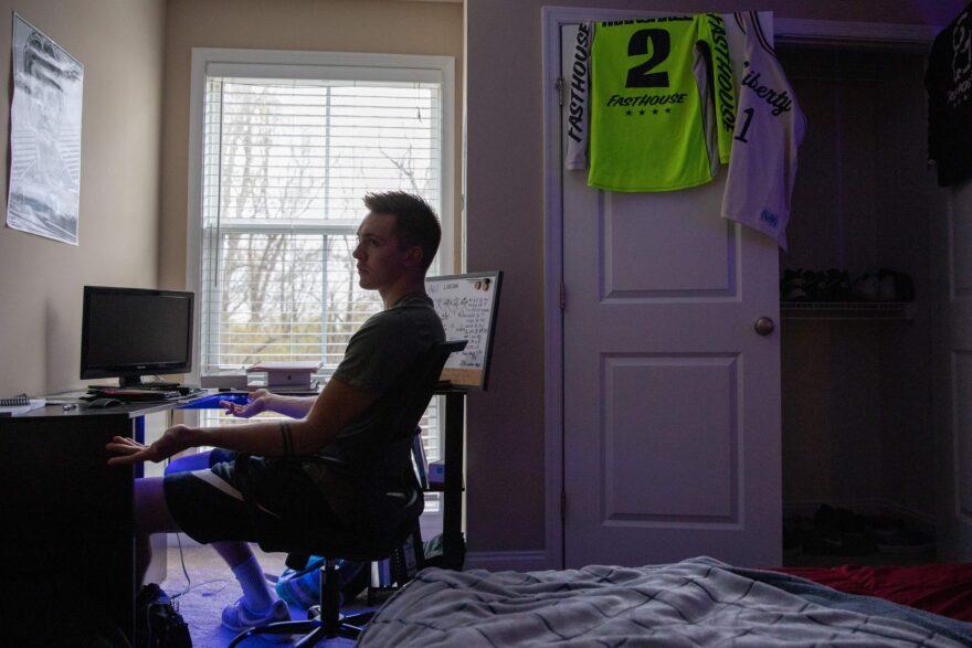 Liberty University student Jared Marshall, sits at his desk inside his apartment near Lynchburg, Virginia.