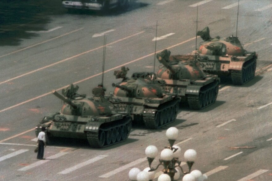 """A Chinese man stands alone to block a line of tanks heading east on Beijing's Cangan Boulevard in Tiananmen Square on June 5, 1989. China faced unprecedented criticism of its brutal repression of unarmed citizens demanding more freedoms. More recently, China has begun promoting its model of """"socialism with Chinese characteristics"""" as the preferred path for advancing human rights."""
