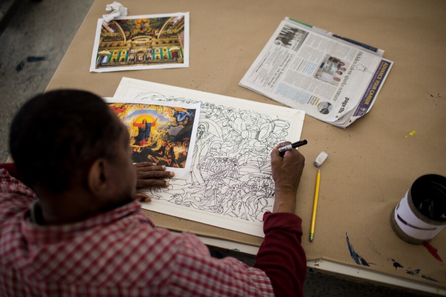 Inspired by an image of Jesus Christ's Last Judgment, artist Raymond Lewis creates a detailed ink drawing in the Art Enables studio.