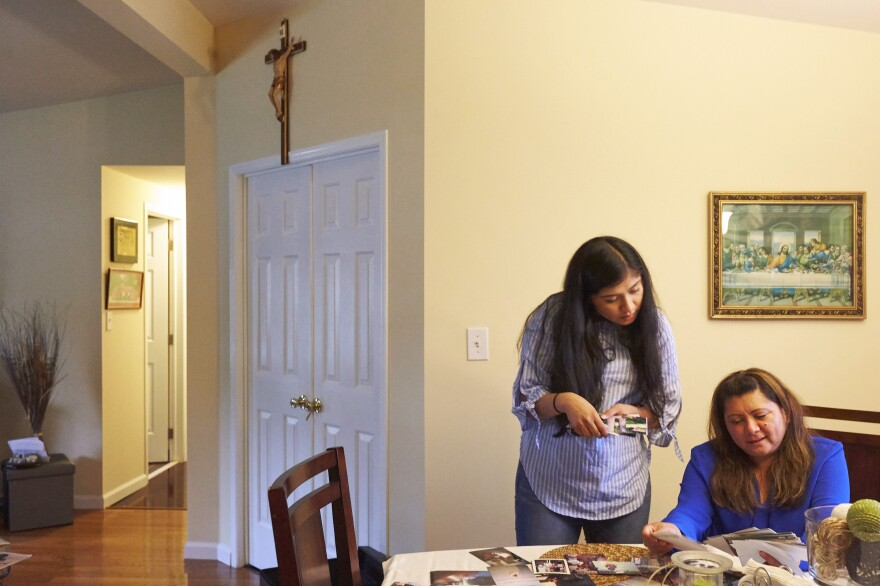 Alondra (left) and her mother, Araceli, look through family photographs after a Sunday Mass and family lunch. Araceli has three jobs to provide for her family.