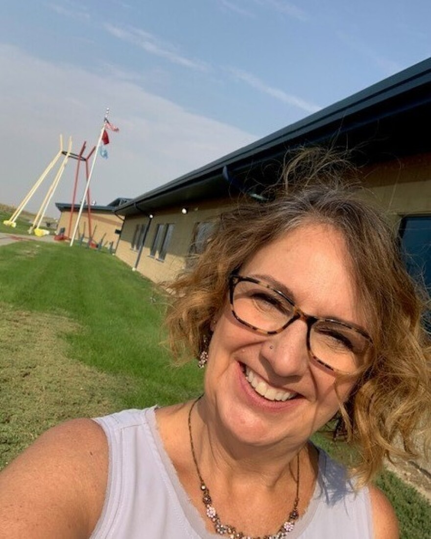 Pam Gunner outside the school she will soon be teaching at on the Pine Ridge Reservation. She feels lucky to have found the job amid the pandemic and has been staving off eviction until she starts getting paid again.
