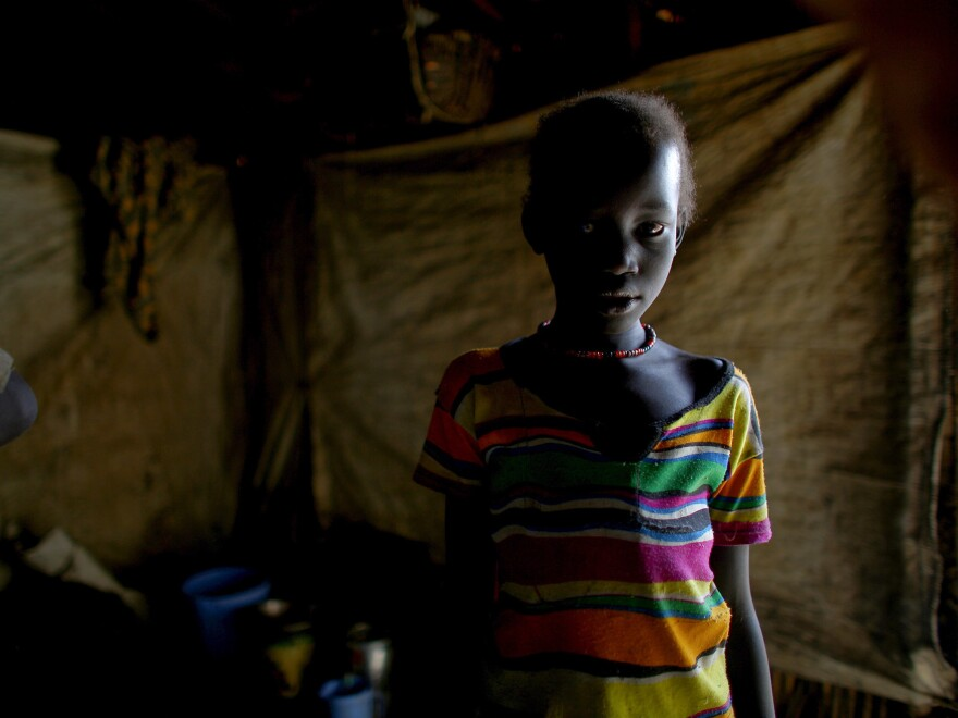 One of the camp's 124,000 residents in her shelter.