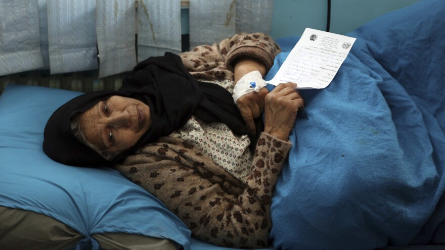 An injured woman receives treatment at a hospital after Monday's attack in Kabul, Afghanistan.