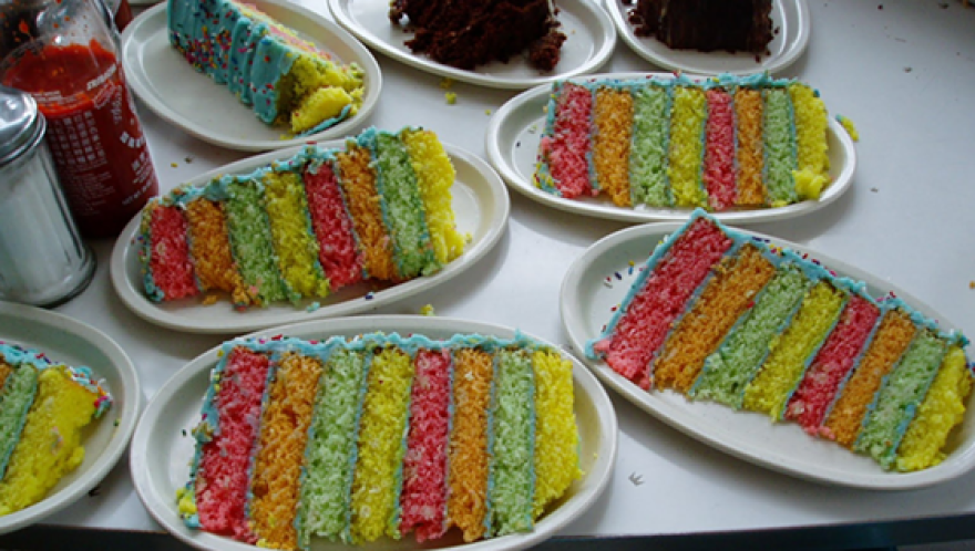 rainbow_cake_on_messy_table_horizontal.png