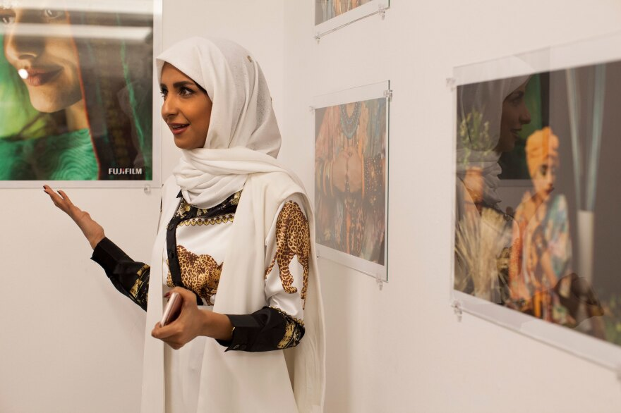 Photographer Sara Alghamdi describes her work to visitors at the Saudi Embassy exhibition.