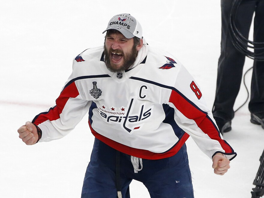 Alex Ovechkin celebrates on the ice after the Capitals defeated the Vegas Golden Knights to win the Stanley Cup. Ovechkin was awarded the Conn Smythe trophy as the best player in this year's playoffs.