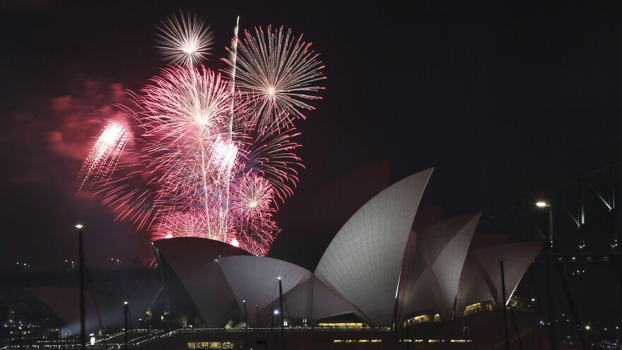 New Year's fireworks explode over the Harbour Bridge and Opera House in Sydney.