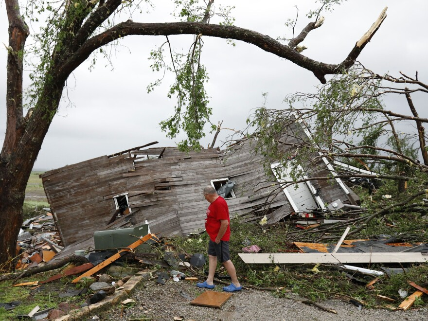 Joe Armison looks over his destroyed barn after a tornado struck the outskirts of Eudora, Kan., Tuesday.