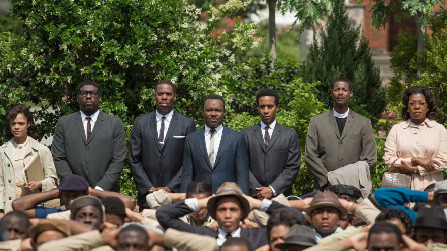 The film <em>Selma </em>stars David Oyelowo (center) as Martin Luther King Jr., and focuses on several unsung activists in civil rights history. But critics say it distorts the role of President Lyndon B. Johnson and others.