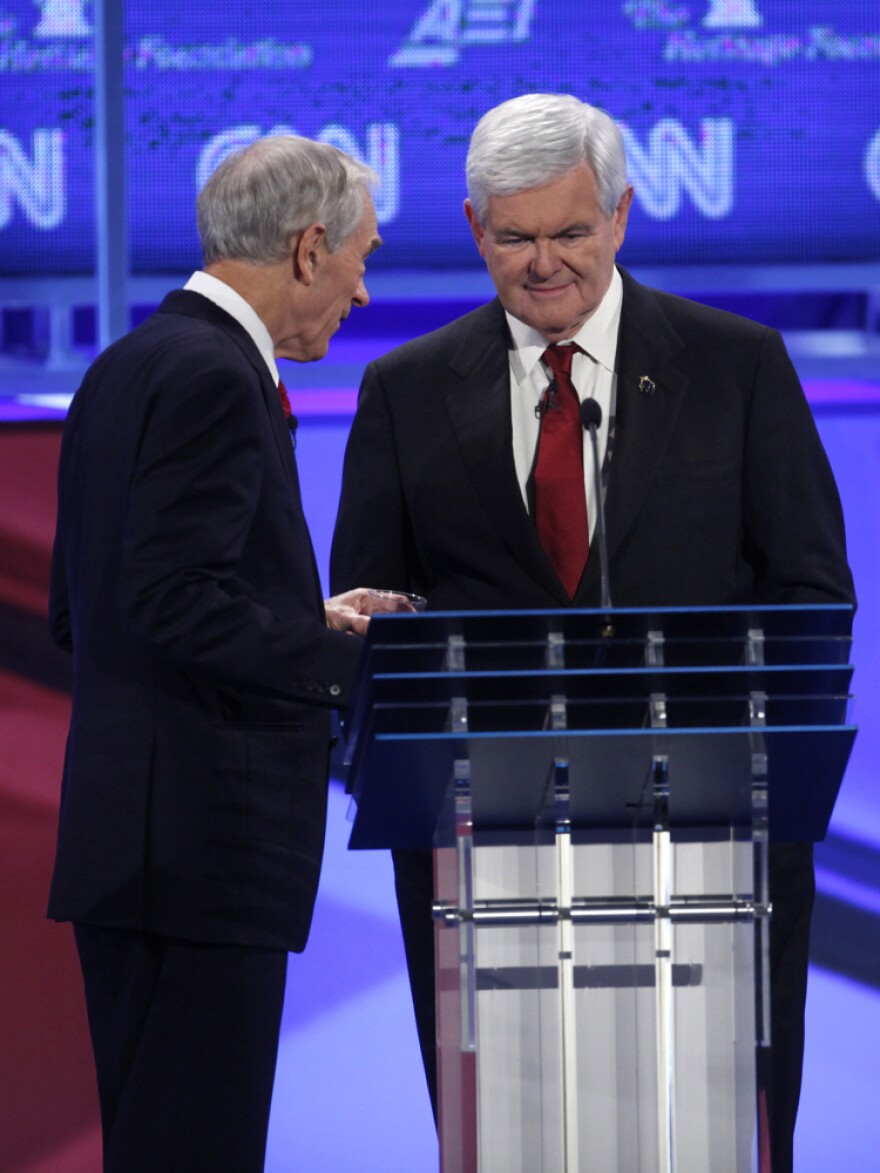 A civil moment that belied the bad vibes between Rep. Ron Paul and Newt Gingrich, Nov. 22, 2011.