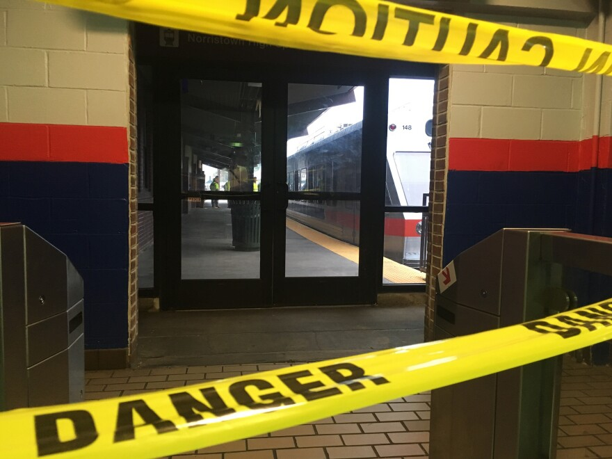 Police tape blocks off a train track at the 69th Street Terminal in Upper Darby, Pa., after a train crash early Tuesday.