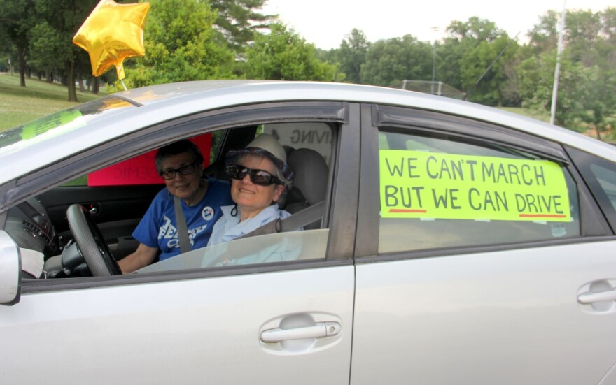 Zuleyma Tang-Martinez (left) organized a car caravan protest on June 20 in University City.