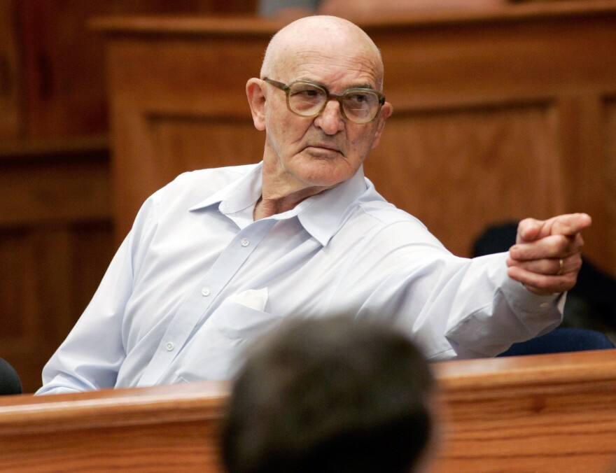 Convicted killer Edgar Ray Killen points to a family member during a recess in an appeal hearing for his bond in Philadelphia, Mississippi, September 9, 2005.