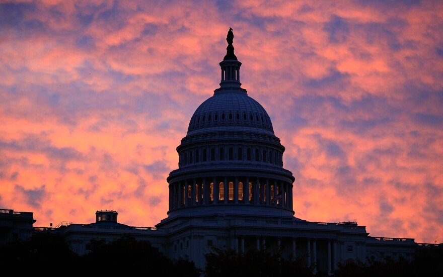 "Filmmaker Ken Burns says America is ""defined as much by our challenges and the dark moments as we are by our successes."" Above, the sun rises behind the U.S. Capitol Building in Washington, D.C."