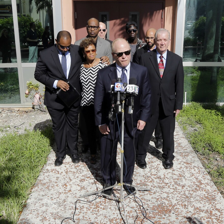 Attorney David Schoen, center, talks to reporters during a news conference in 2015 with the family of Jermaine McBean, who was shot and killed by a sheriff's deputy while carrying an air rifle, in Fort Lauderdale, Fla.