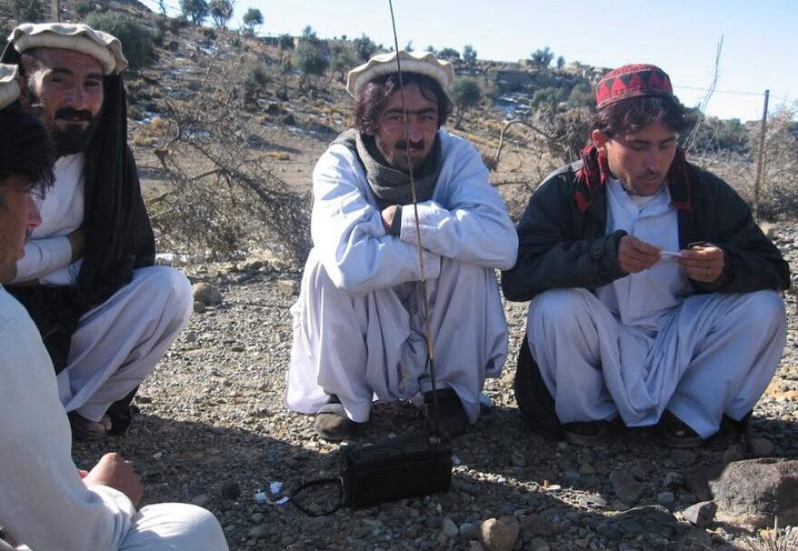 Locals listen to Radio Miransh in the North Waziristan Agency.