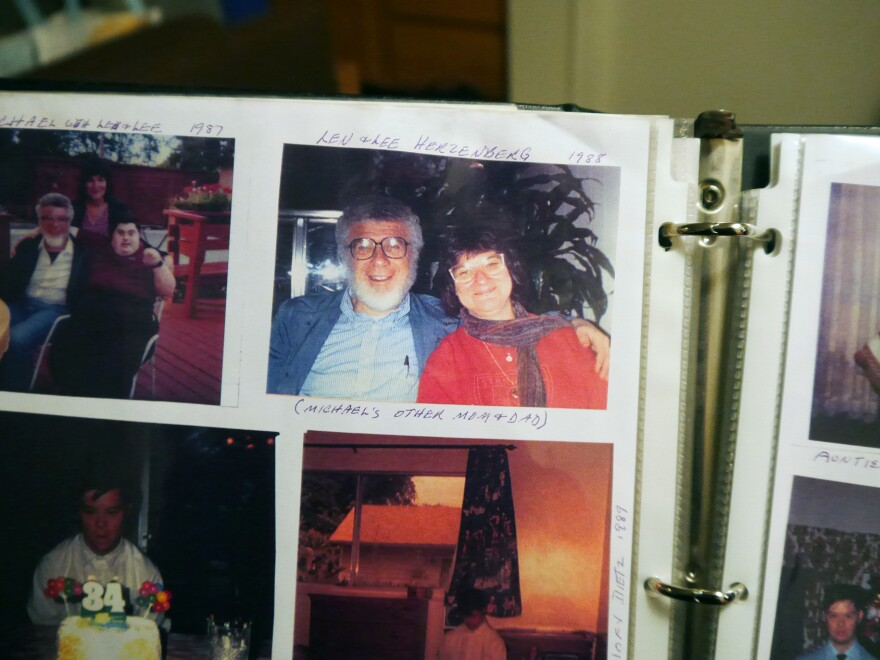 One of Michael's albums, with a photo of his birth parents, Lee and Len Herzenberg.