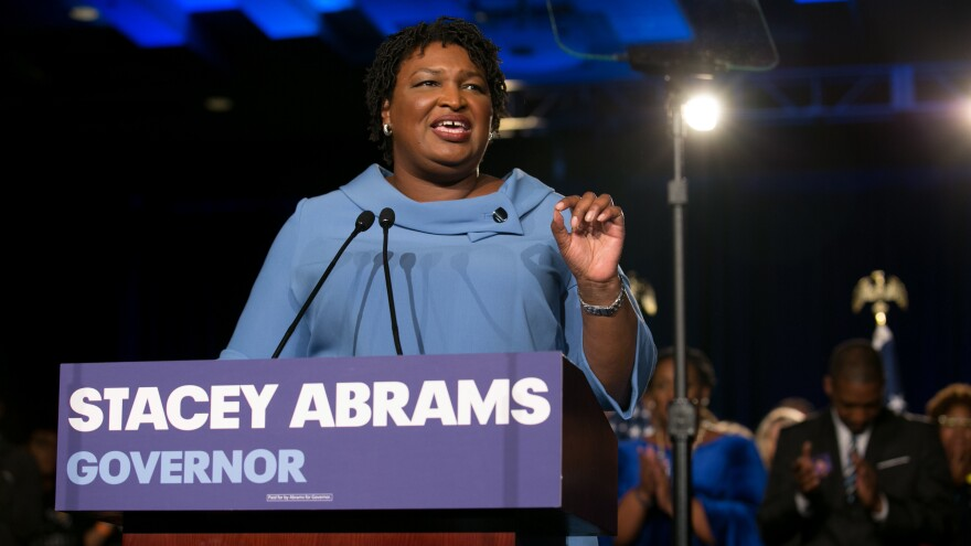 Democratic gubernatorial candidate Stacey Abrams addresses supporters at an election watch party on Tuesday. Abrams has not conceded to her Republican opponent, Brian Kemp, contending there are thousands of absentee and provisional ballots yet to be counted.