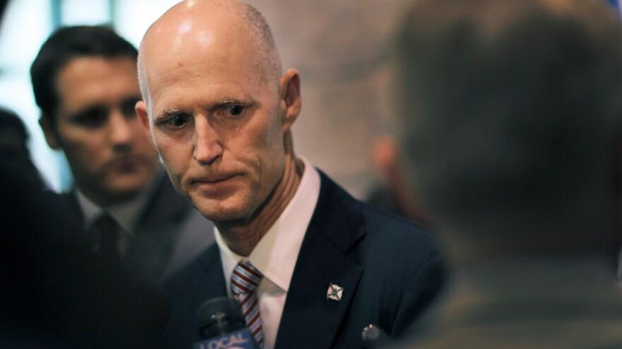 After signing a Florida budget that cuts billions, Republican Gov. Rick Scott has seen his approval rating drop.