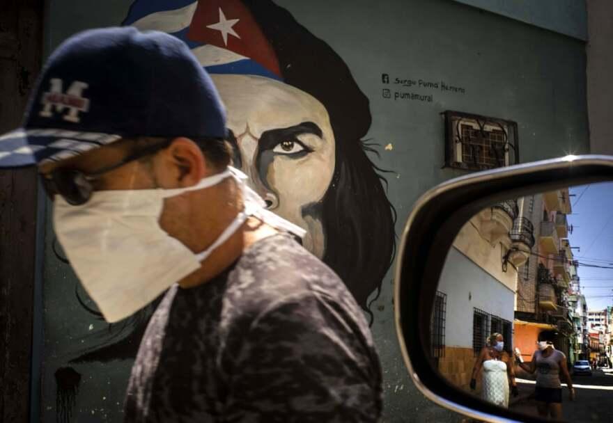 A Cuban man wears a protective mask in Havana.