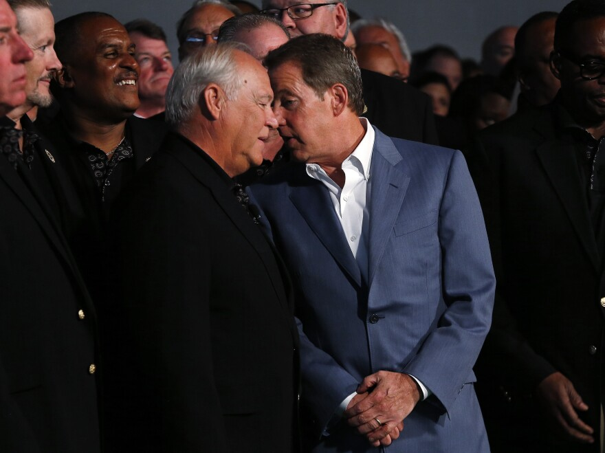 United Auto Workers President Dennis Williams (left) and Ford Motor Executive Chairman William Clay Ford Jr. at a ceremony marking the opening of contract negotiations in July.